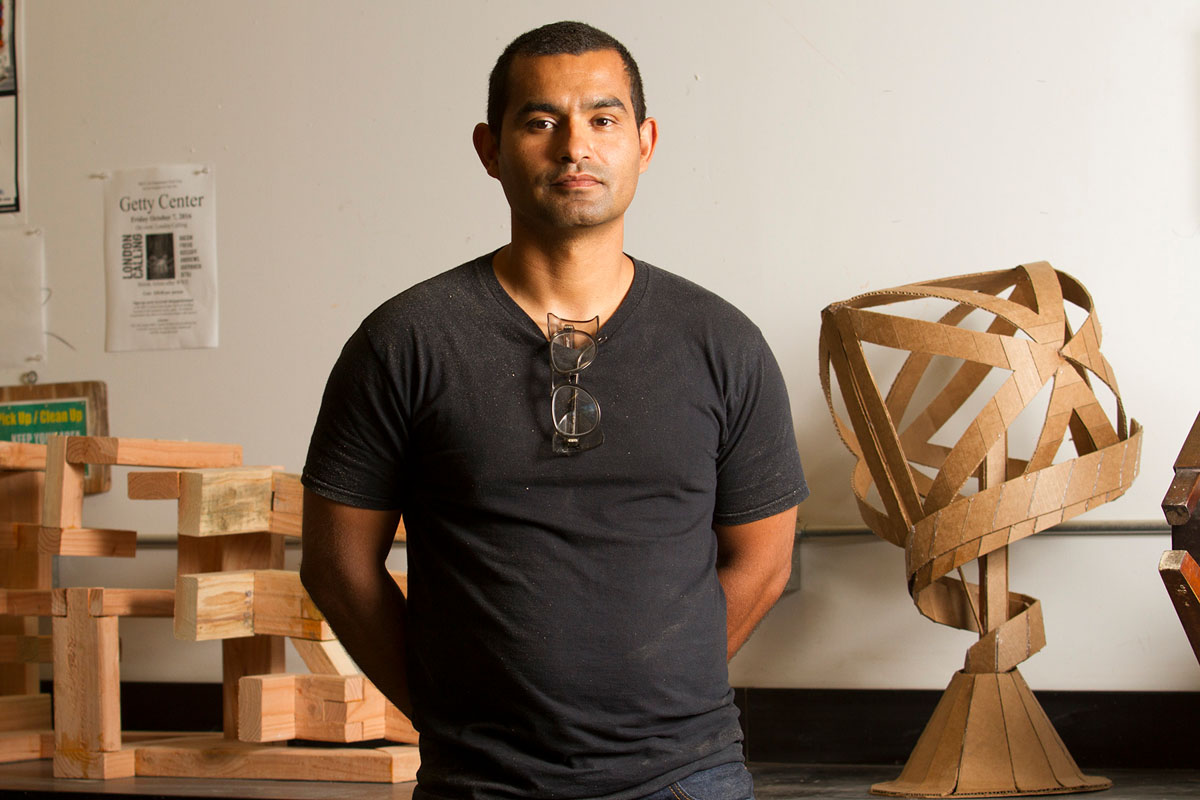 Dallas, Texas native Armando Ramos stands with student sculptures on Monday, Oct. 3, 2016, in his lab in the Humanities building at City College. City College Professor Ramos specializes in 3D sculptures made from all different types of material, such as wood and cardboard.