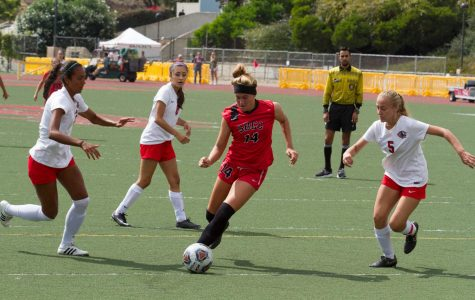 Forward Lourdes Gilbert runs the ball against Chaffey College's Emma Burgos (No. 3), Brianna Esquivel (No. 8) and Taylor Windham (No. 5) Tuesday, Sept. 19, at La Playa Stadium at City College. The Vaqueros won this game 2-0 and will play Victor College 2 p.m. Friday, Sept. 22 at Victor College.