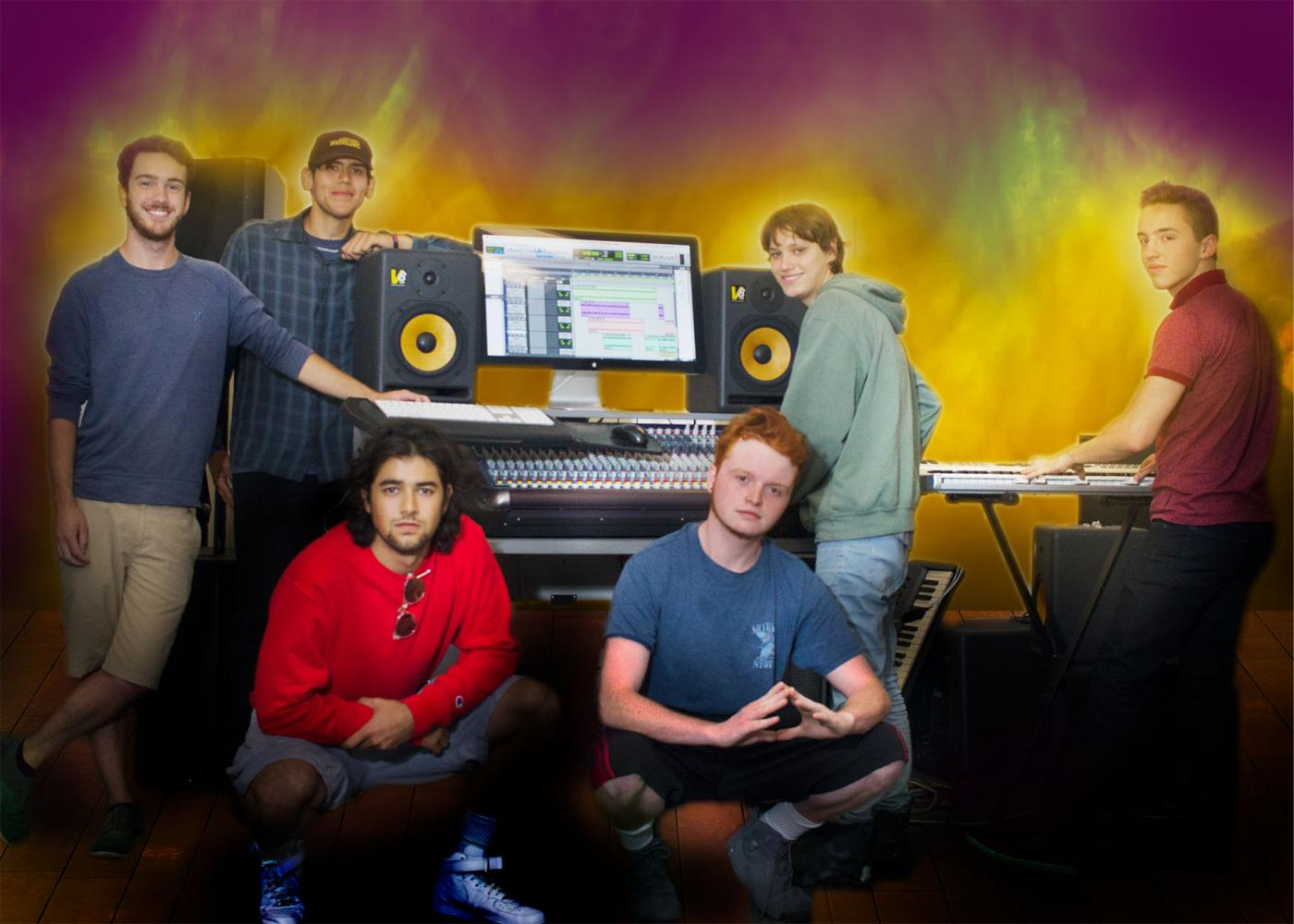 Students pose with music equipment Wednesday Sept. 20, which they learn to use in James Watson's electronic music recording class at City College. The goal of this class is to get students comfortable with the equipment and prepare them to get a job in the music industry.