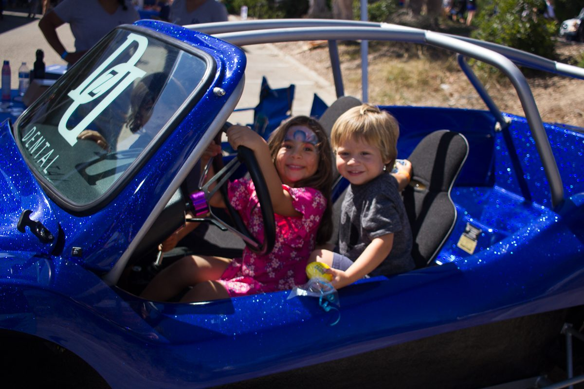 Giselle Guillen and Ezekial Karina sit a the wheel of a blue dune buggy during the annual Touch-A-Truck event Sunday, Sept. 24, 2017, at City College in Santa Barbara, Calif. All the machines on display were donated for the day by Postpartum Education for Parents program's parent organizations.