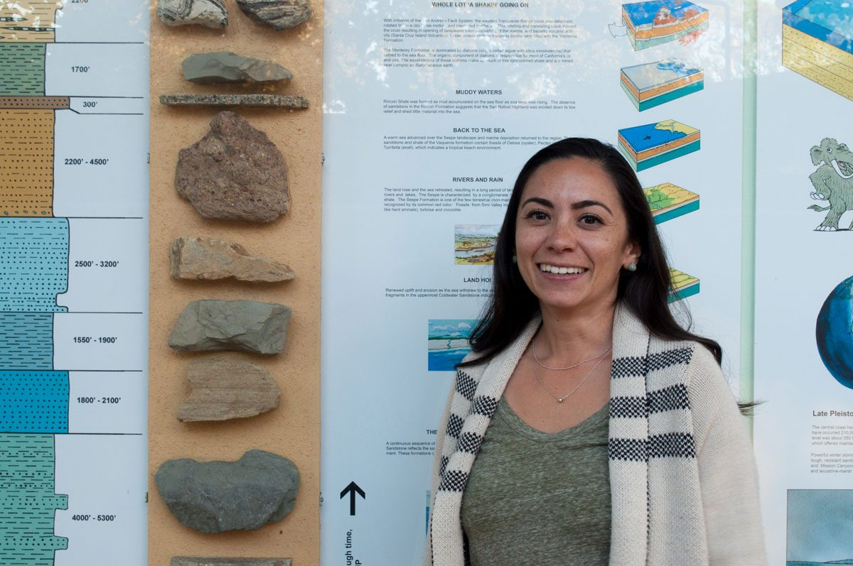 Stephanie Mendes, new full-time earth and planetary sciences instructor, stands next to rock samples Tuesday, Sept. 19 at the Earth and Biological Sciences Building in City College. Mendes received her doctorate in Marine Biology and Geochemistry at UCSB in 2014 and now teaches oceanography and historical geology.