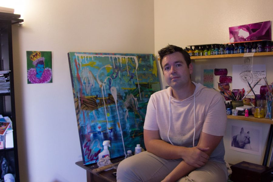 Bryan Austin Gillison posing next to his art in his studio Friday, Oct. 13, in Goleta, Calif. Gillison runs a sex-positive website called Boston Elements to promote his art.