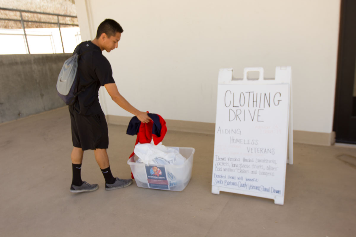 Andres Castro, Sophomore Track and Field sprinter, showing The Channels how easy it is to drop off clothes for the Clothing Drive Oct. 9 outside the Physical Equation building. The Santa Barbara County Veterans Stand Down and the City College athletic department partnered to create the clothing drive that will help homeless veterans in the community.