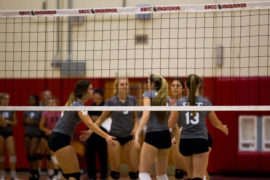 The Lady Vaqueros women's volleyball team huddles after a kill in a match against Cuesta College Wednesday, Oct. 25, at the Sports Pavilion. The Vaqueros swept the Cougars 3-0.