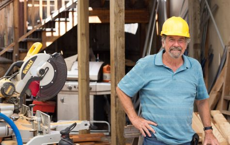 Patrick Foster, Head of the construction company, hangs out in his lumber room Thursday, Oct. 5 at the City College Wake Center. Foster is retiring from the program this semester.