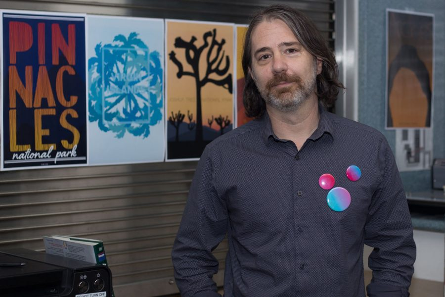 James Vanarsdale stands in his office with some of his students work Wednesday, Oct. 18, at City College. Vanarsdale is a Santa Barbara based graphic designer who was brought in to rebuild the graphic design program.