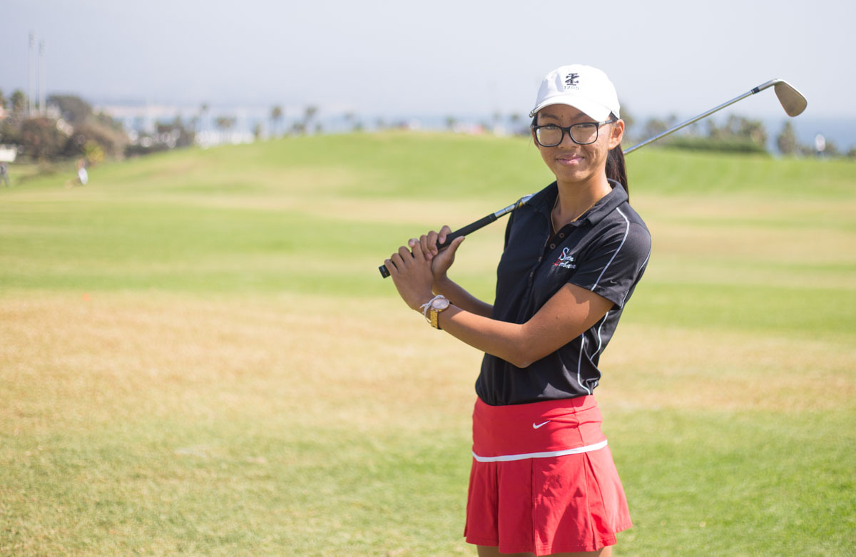 Vanessa Watkins Poses with her club, Thursday, Oct. 12 on the West Campus meadow. Watkins is a sophomore at SBCC and is a stand out player on the golf team shooting under 80 each match.