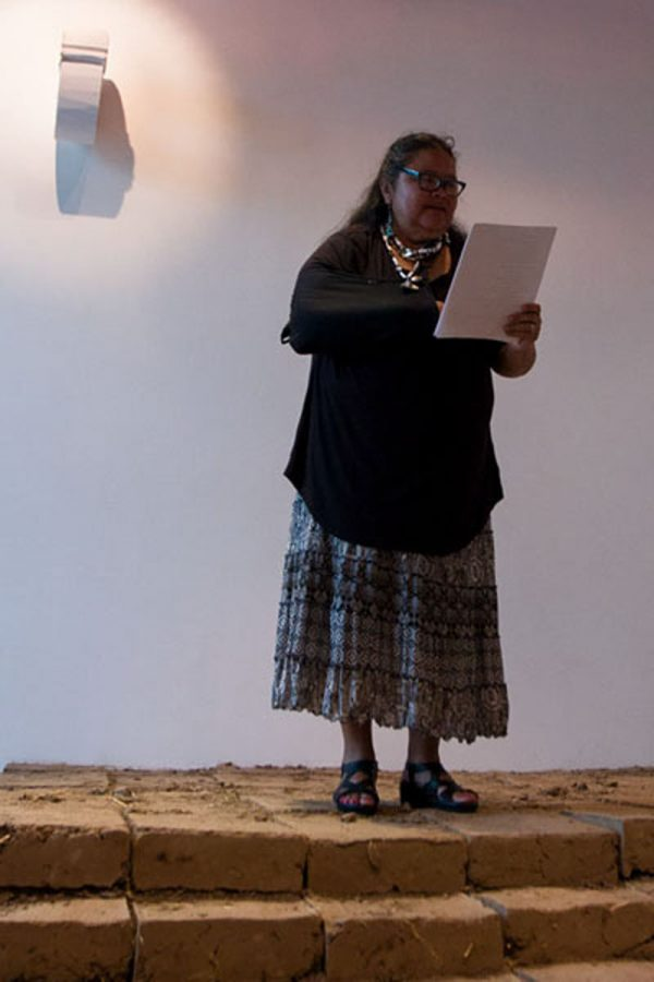 English teacher Annette Cordero recites two poems at the Day of the Dead poetry reading event.