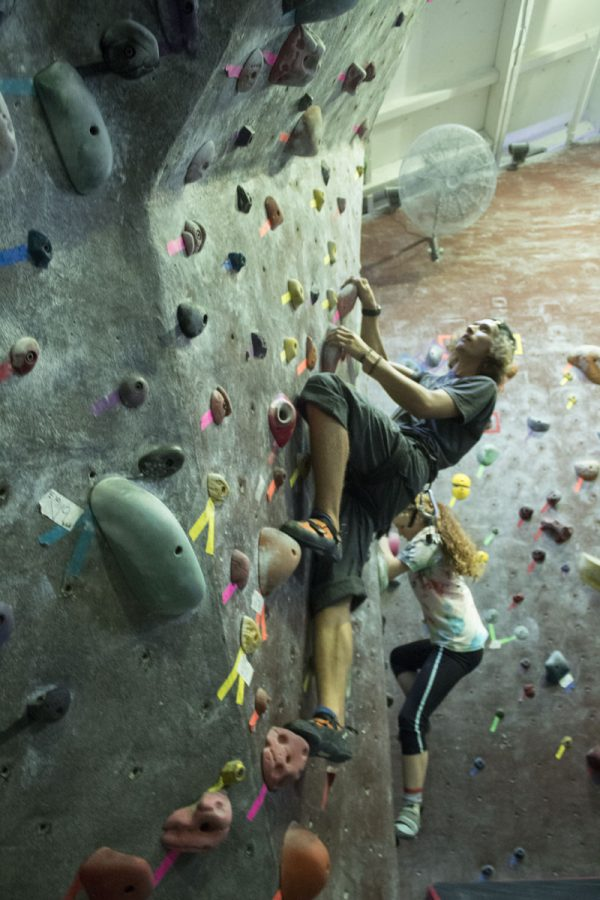 Aidan Andersen climbing up a rock wall Thursday, Nov. 9, at the Santa Barbara Rock Gym downtown.