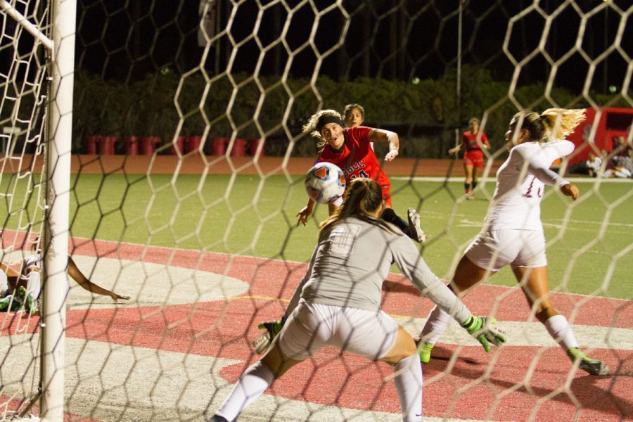 City College forward Lourdes Gilbert (No. 14) scores the first goal against the Antelope Valley College Marauders Saturday night, Nov. 18, at La Playa Stadium. Gilbert scored two of the four goals during the women's soccer teams first round playoff game.