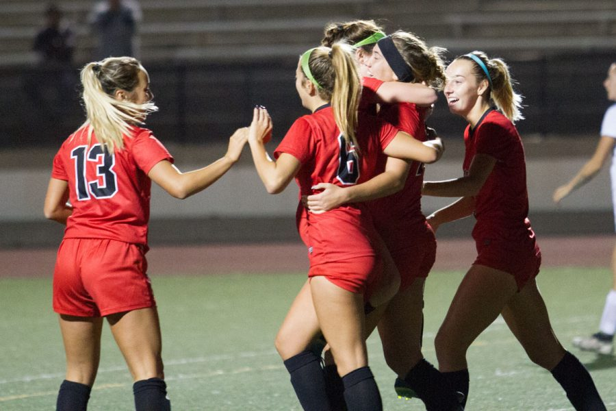 Lourdes Gilbert (center right) celebrates with her teammates after scoring her second goal of the night Saturday, Nov. 18, at La Playa Stadium. City College devastated Antelope Valley College 4-0 and will be playing Orange Coast College next Tuesday.
