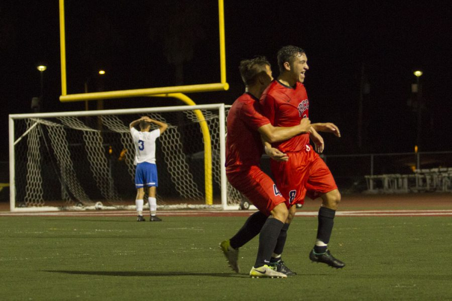 Jessie Jimenez (No. 8) and Andrew Wakamiya (No. 4) celebrating after Jimenez scored the Vaqueros' second goal of the night against the Santa Monica Corsairs Thursday, Nov. 9, at La Playa Stadium. The Vaqueros won 3-2 making them undefeated in league.