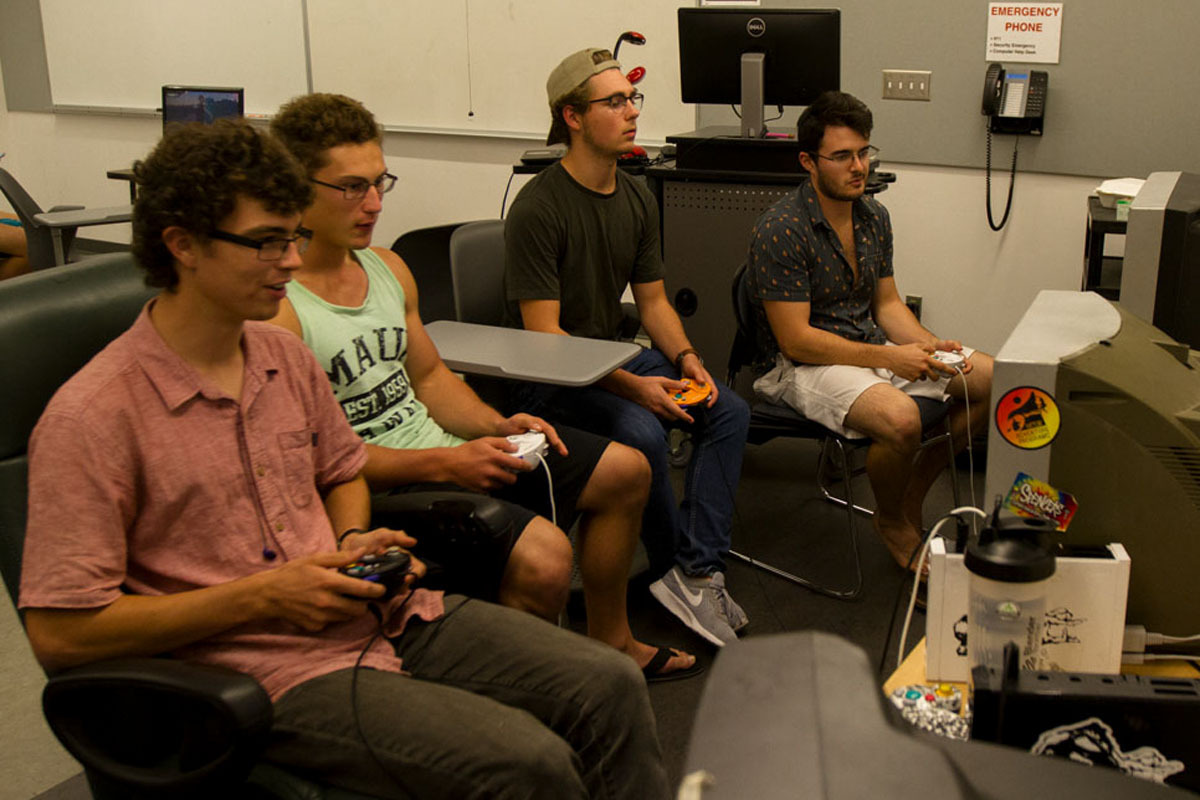 (From left) Club members Jacob Harms, Jake Hammond, Johnny Muhlenkamp and Will Yzaguirre focus as they play two separate Super Smash Bros. Melee matches Wednesday, Oct. 25, in Humanities Building Room 240. The Super Smash Bros. club brings their own gear from home including T.V.'s, consoles and controllers and set them up to practice for future competitions.