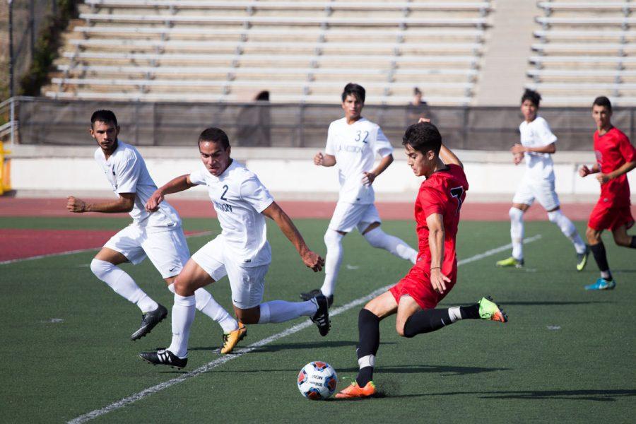 City College player Carlos Espinoza (No. 7) attempts to kick a goal Friday, Nov. 3, at La Playa stadium. The Vaqueros defeated LA Mission 4-1.