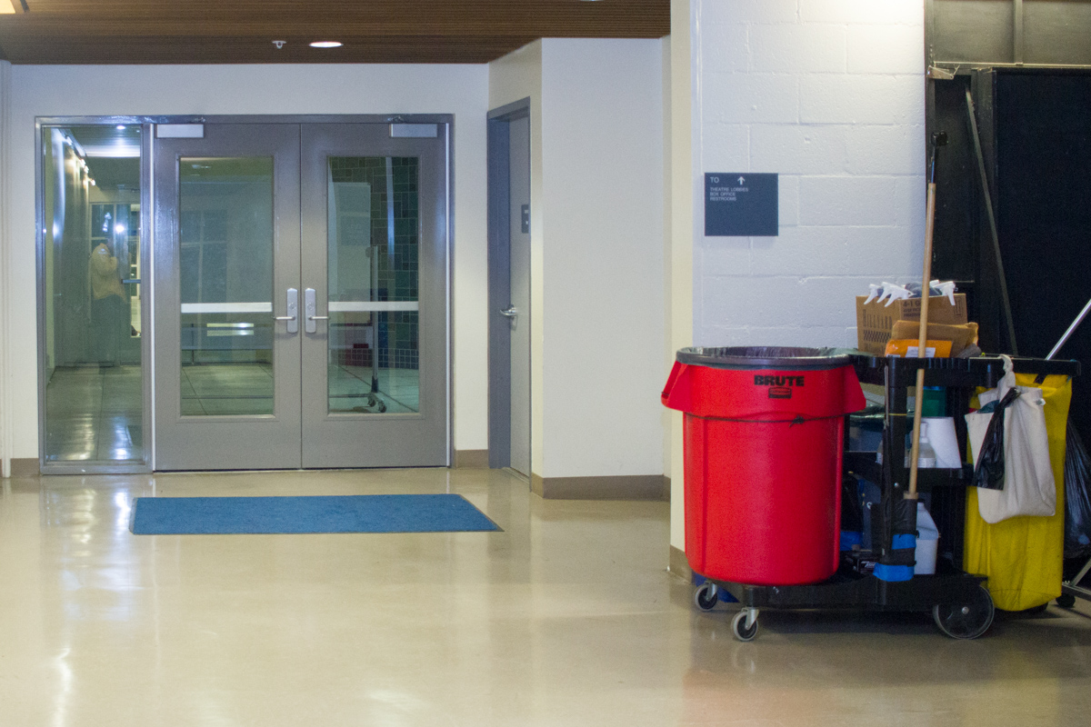 A janitorial cart rests after the Drama and Music Building Thursday night, Nov. 16, at City College. The janitorial staff attempts to keep the City College campus clean even with recent budget cuts and staffing shortages.