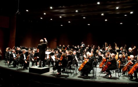 Professor JamesMooy's conducts the City College symphony during their live performance atthe Garvin Theatre Sunday, Nov. 19.