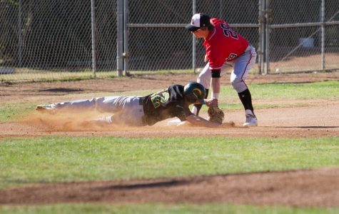 From right, Jake Holton, City College Vaqueros (no. 29) tags out Aaron Reardon, Napa Valley Storm (no. 12) on third base. The game was held at Pershing Park on Saturday, Jan. 27 in Santa Barbara.