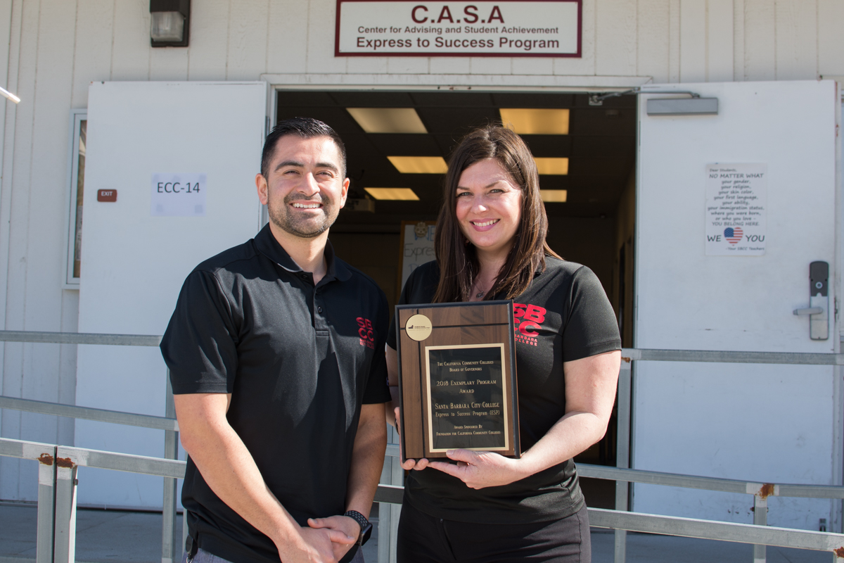 Andrew Gil (left) and Cosima Celmayster-Rincon holding the California Community Colleges Board of Governors Exemplary Program Award honoring the Express to Success Program at Santa Barbara City College in Santa Barbara on Thursday, Feb. 15. Gil has been with the Express to Success program for two years and Celmayster-Rincon has been with the program for seven years.