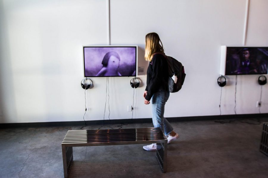 Hayze Law examines stop-motion films at the Atkinson Gallery at Santa Barbara City College on Thursday, Feb. 15. The exhibition, 'Girlhood' features work from Rita Basulto, Laura Krifka, Heidi Kumao, Kirsten Lepore, and Suraya Raj.