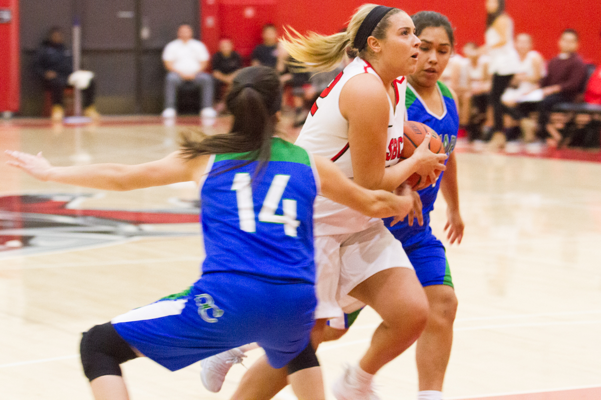 Vaquero Aaliyah Pauling (no. 32) goes for a layup while Maxine Holguin (no. 14) and Airin Lara (no. 1) from Oxnard College attempt to block her. The game was held at the Santa Barbara City College Sports Pavilion on Wednesday, Feb. 7. The City College Vaqueros beat the Oxnard College Condors 79-42.