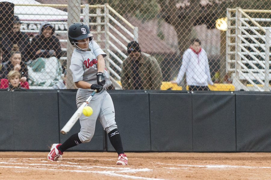 """Sloane Greeley hits a line drive single to right field against Orange Coast College with the bases loaded to give the Vaqueros a 1-0 lead in the bottom of the first inning on Friday, Feb. 9 at Pershing Park in Santa Barbara. """"Singles do it,"""" Greeley said."""