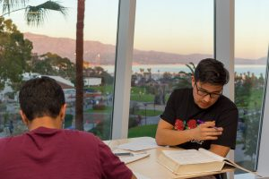 Rubin Gonsalves, in burgundy, and Eduardo Fabian, wearing black, study in the new West Campus Classrooms Building at Santa Barbara City College, on January 31. The new building offers an open study space for students to enjoy the views throughout the day.