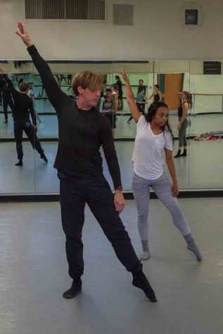 Tracy Kofford demonstrates techniques in posing with Camara Byrd in the Physical Education Building Room 113, at Santa Barbara City College on Friday, Feb. 23. Kofford routinely shows the dancers in his group little improvements they can make to their form to prepare them for competition.