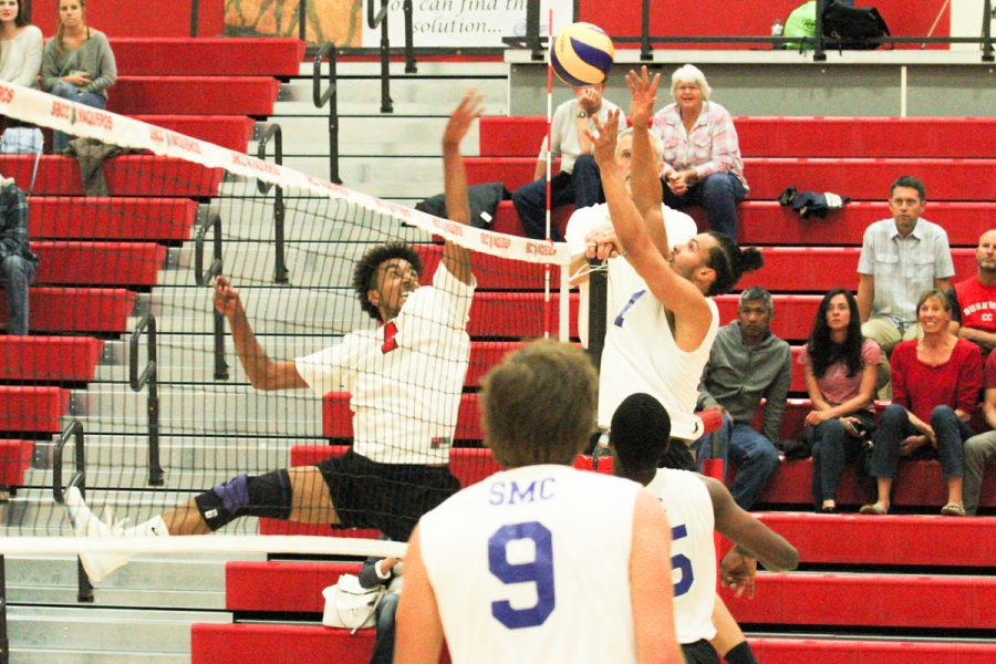 Outside hitter Haward Gomes (No. 4) hits a point for the Vaqueros on Wednesday, Feb. 28, in the Sports Pavilion at Santa Barbara City College. The Santa Barbara City College mens volleyball team played the Santa Monica College Corsairs.