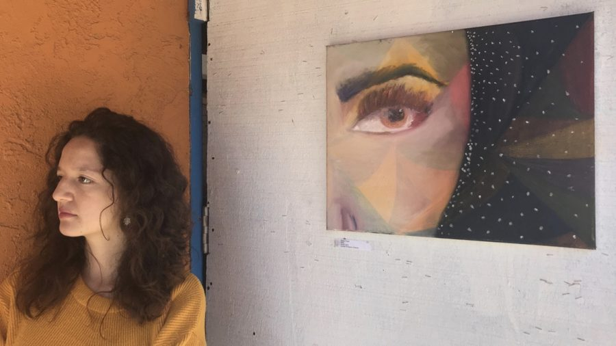 Camila+Rodriguez+stands+next+to+her+acrylic+painting+%E2%80%9CSlowly+Freed%E2%80%9D+as+guests+come+to+the+ART+118+pop-up+show+on+Friday%2C+March+23%2C+at+the+Biko+House+in+Isla+Vista.