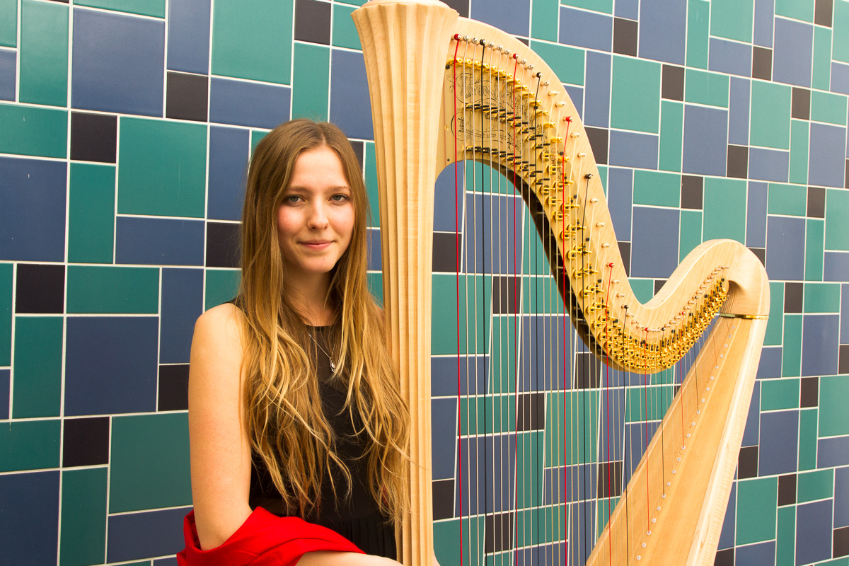 Santa Barbara City College's new harp, acquired in November of 2017, is played by student harpist Ginger Brucker outside the Garvin Theater, in Santa Barbara. The $25,000 pedal harp will appear in a symphony on May 6 at the Garvin Theater.