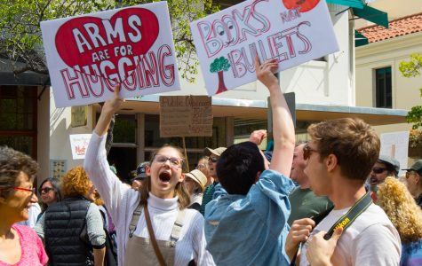 Eva Beebe(Left), and Stella Moore chant and raise their signs during the March For Our Lives protest on Saturday at De La Guerra Plaza in Santa Barbara. March For Our Lives protesters stand in solidarity with the survivors of the Stoneman Douglas High School massacre in honor of the kids and teachers who died there and in support of all students who fear for their lives.