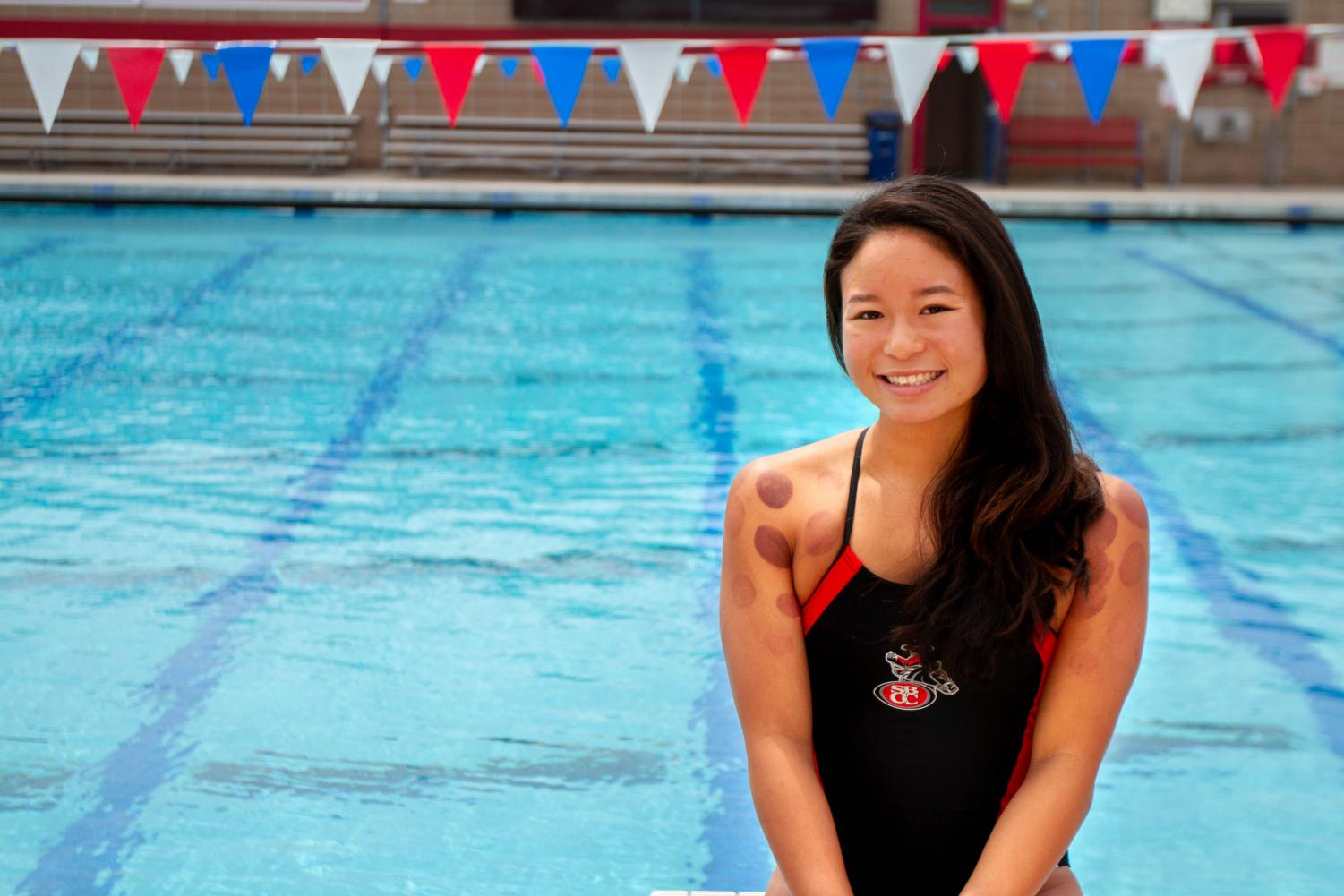 Kelee Shimizu, a freshman swimmer at Santa Barbara City College, competes in the freestyle for the Vaqueros who practice at the San Marcos High School pool. Shimizu uses cupping therapy to relieve muscle tightness before meets.