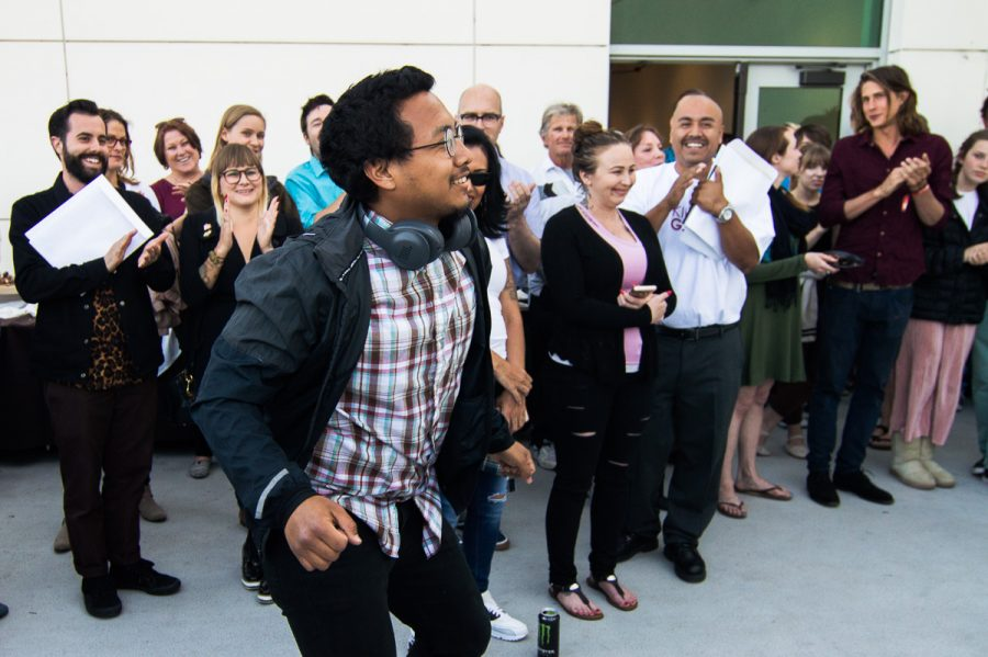 Alejandro Martinez dances his way up to receive his scholarship award at the Atkinson Gallery. Martinez received $4,500 for the Eli Luria Honorary Scholarship in Studio Art.