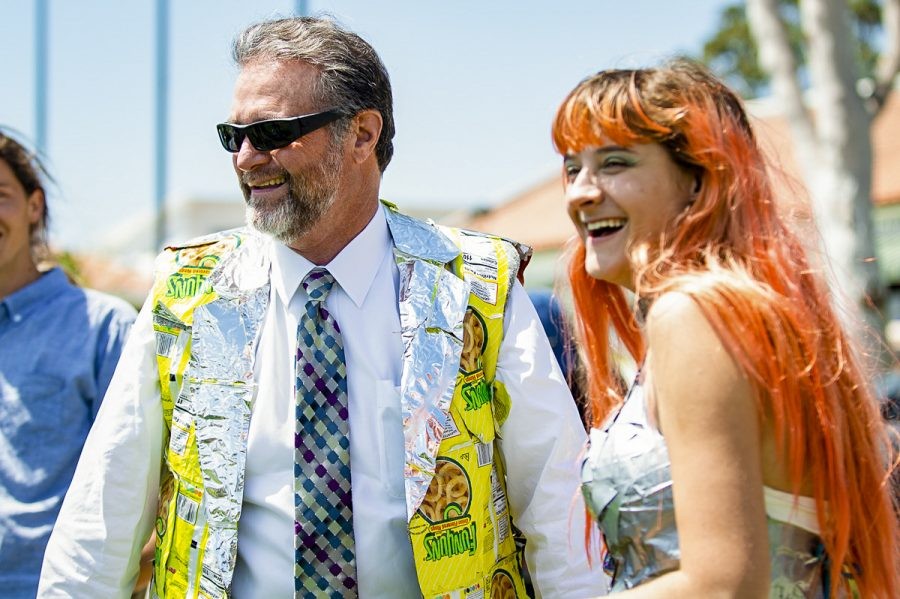 Superintendent/President Anthony E. Beebe tries on his new suit vest made of Funyun bags on Thursday, at the Earth Day gathering at City College. The vest was presented by Frances Manthrope after the Trashion Show, where students wore attire made of repurposed materials.