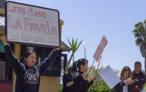 Alondra Lazaro Gonzalez, Denise Lazaro, and Nereida Rangel hold signs in protest April 16 outside the Favela cafe on East Campus at Santa Barbara City College. The students are protesting to bring awareness of student workers losing their jobs with little notice, and the loss of diverse, comfort food on campus.