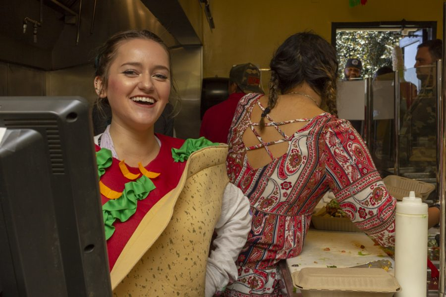 Rachael Young, a cashier at Favela cafe says she is moving through orders faster than usual as a rush of customers come through to support the Favela cafe on its last day of operation on Thursday, April 26, 2018, at Santa Barbara (Calif.) City College.
