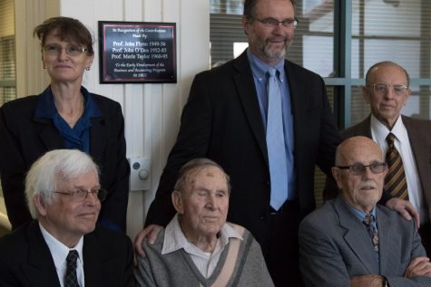 Accounting department co-chairs Cornelia Alsheimer-Barthel and Alfonso Vera-Graziano (top right), and Superintendent-President Anthony Beebe honor John Flynn, John O'Dea and Merle Taylor with a plaque on Monday in the Business-Communication Center. Flynn's son (bottom left) came to the event on his father's behalf and celebrated with O'Dea (seated in the middle) and Taylor.