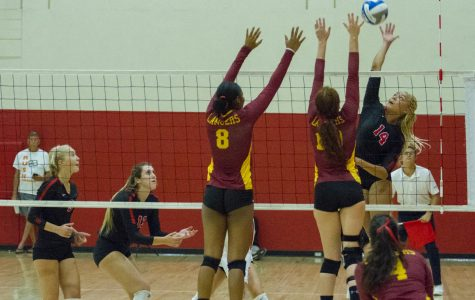 City College outside hitter Jazz Hill (No. 14) attempts a spike against Pasadena City College middle blockers Jada O'Mally (left, No. 8) and Rachel Johnson (No. 16) at the Sports Pavilion gym at City College in Santa Barbara, Calif., on Saturday, Sept. 8, 2018.