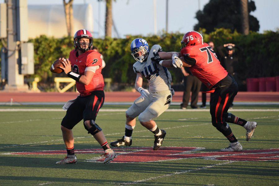 City College quarterback Gerald Hickson (No. 2) attempts a pass while Ramon Lazarit (No. 75) blocks Zach Stauffer (No. 44) of San Bernardino Valley at La Playa Stadium at City College in Santa Barbara, Calif., on Saturday, Sept. 8. The Vaqueros lost to the Wolverines 35-13.