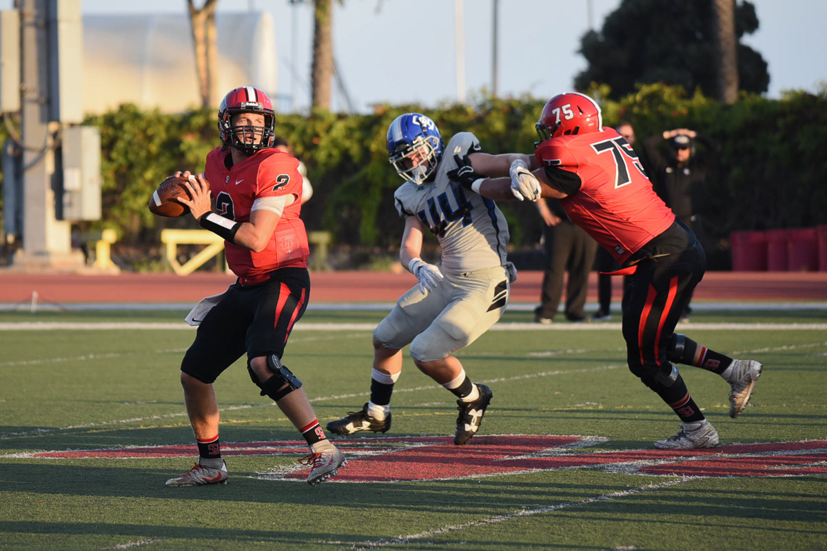 City College quarterback Gerald Hickson (No. 2) attempts a pass while Ramon Lazarit (No. 75) blocks Zach Stauffer (No. 44) of San Bernardino Valley at La Playa Stadium at City College in Santa Barbara, Calif., on Saturday, Sept. 8. The Vaqueros lost to the Wolverines 35-13.