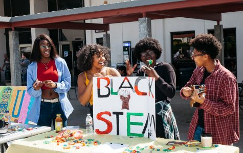 "City College student Alexis Willis plays the ukulele while fellow Black Stem Club members Tiffany Love, in black, Jordan Cornett, in yellow, and Naiha Dozier-El, in blue, sing along and dance on club day at the Friendship Plaza at City College in Santa Barbara, Calif., on Wednesday, Sept. 26. ""We have a community that we can thrive together and make sure we all feel united,"" Love said."