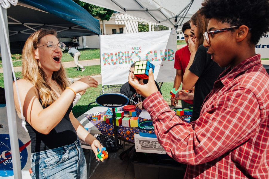 Alexis Willis (right) impresses Emily Hayman by solving a rubik's cube on club day at the Friendship Plaza at City College in Santa Barbara, Calif., on Wednesday, Sept. 26. This will be the first year for the rubik's club at City College.