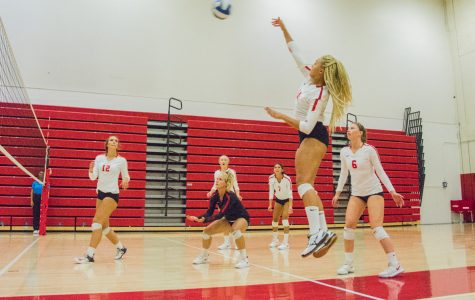 City College opposite hitter, Jazz Hill (No. 14), hits the ball at the Sports Pavilion Gym in Santa Barbara, Calif., on Saturday, Sept. 15, 2018 Hill helped the Vaqueros score in their 25-6 set win.