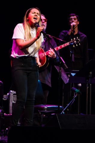 Tess Erskine sings alongside John Clark, City College's music department Chairman, at the Lobero Theatre in Santa Barbara, Calif., on Wednesday, Oct. 10, 2018. Erskine grew up in a musical household and has been singing and creating music from an early age.