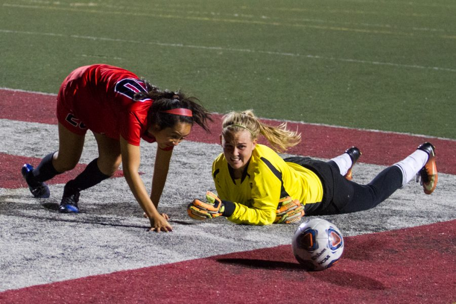 City College forward Alejandra Alvarez (No. 20) attempts to steal the ball from Cuesta College goalkeeper Brenae Damery (No. 0) at La Playa Stadium on Tuesday, Oct. 16, 2018, in Santa Barbara, Calif. Damery had a total of 16 saves that game, but the Lady Vaqueros still defeated the Cougars 2-0.