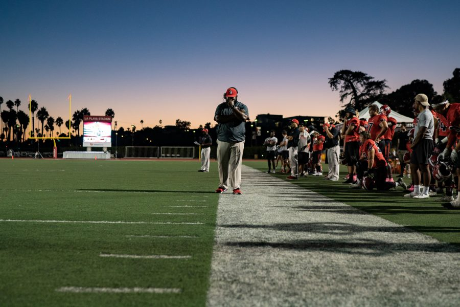 Defensive coach Don Willis waits on the side lines as the athletic trainers and head coach take the field to check on Tamir Walker (No.23) after a hard collision on Saturday, Oct. 20, 2018, at La Playa Stadium at Santa Barbara City College, in Santa Barbara Calif. L.A. Harbor defeated City College 17-14.
