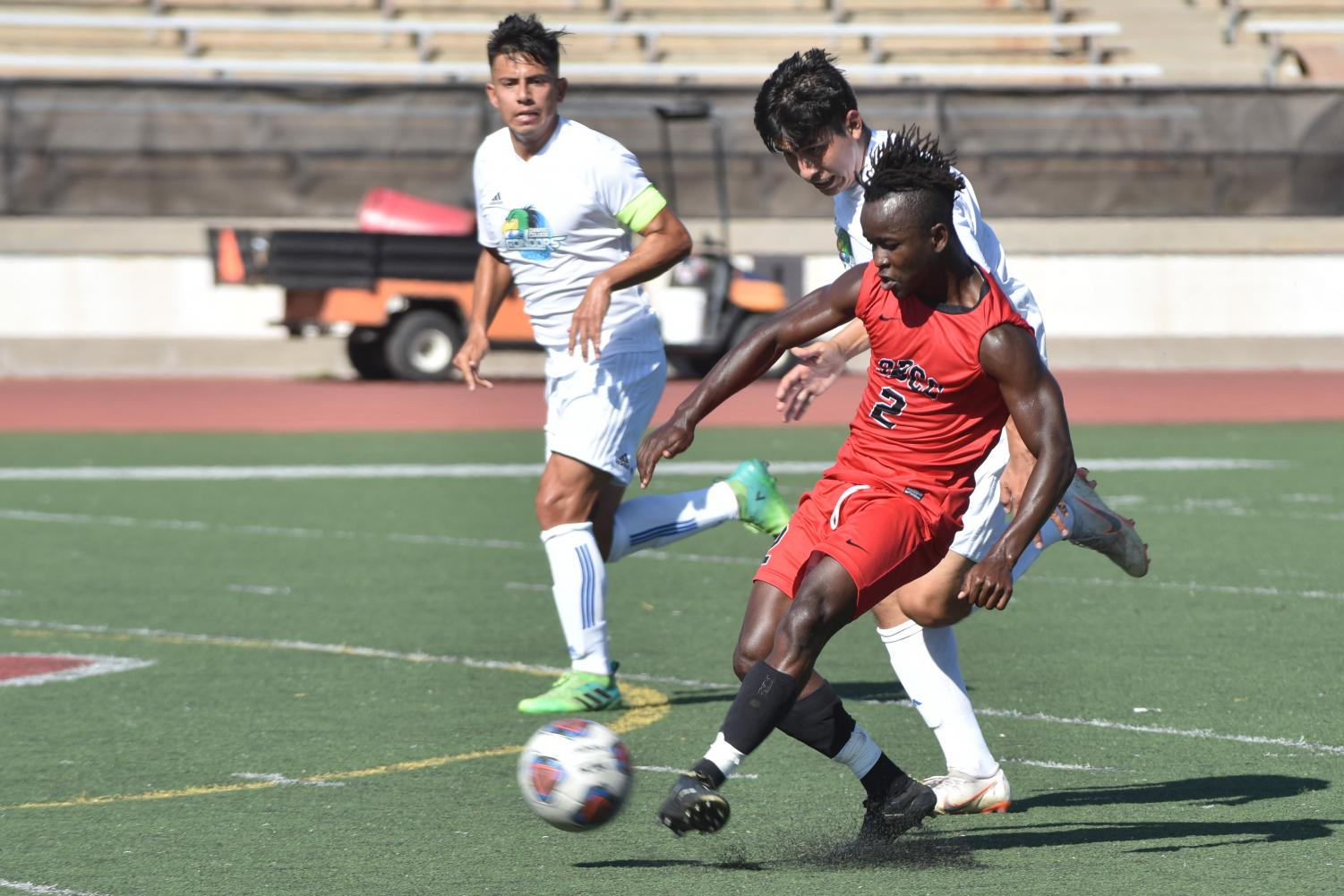 Oxnard College players follow close behind City College player Ameyawu Muntari (No.2) as he passes the ball on Tuesday, Oct. 30 at Santa Barbara City College's La Playa Stadium. The Condors and Vaqueros tied 1-1.