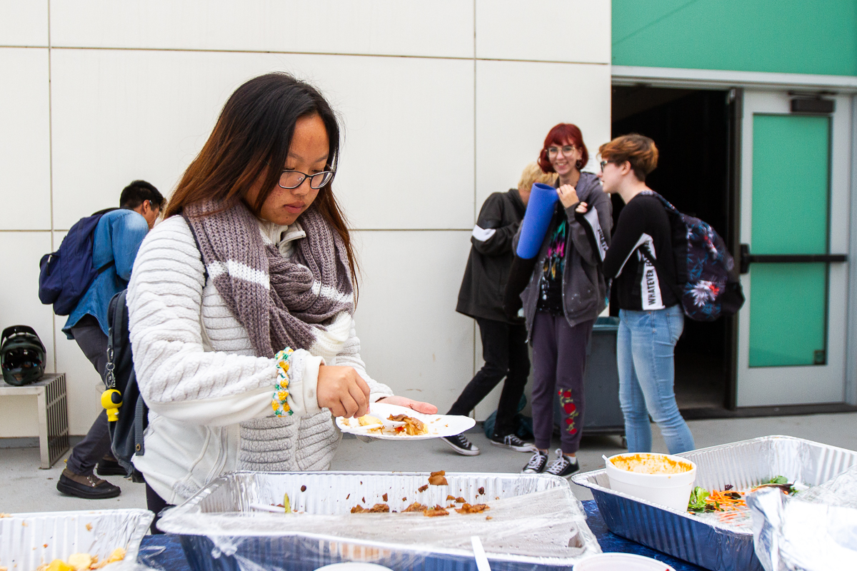 Valerie Moua serves herself food at the club mixer the Associated Student Senate arranged on Monday, Nov. 19, at the Atkinson Gallery at City College in Santa Barbara, Calif. The club mixer offered free food, and students had the chance to meet new people and find clubs to join.