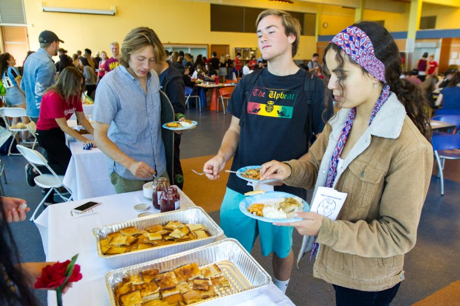 From left, Francesco Velez-Quilici, Eric Thornburgh, and Jasmine Salik serve themselves Finnish pancakes at the annual International Food and Culture Fair hosted by the City College Ambassadors on Friday, Nov. 16, at the East Campus cafeteria at City College in Santa Barbara, Calif. The Finnish dish, also known as pannkakku, is made in the oven and usually for dessert.