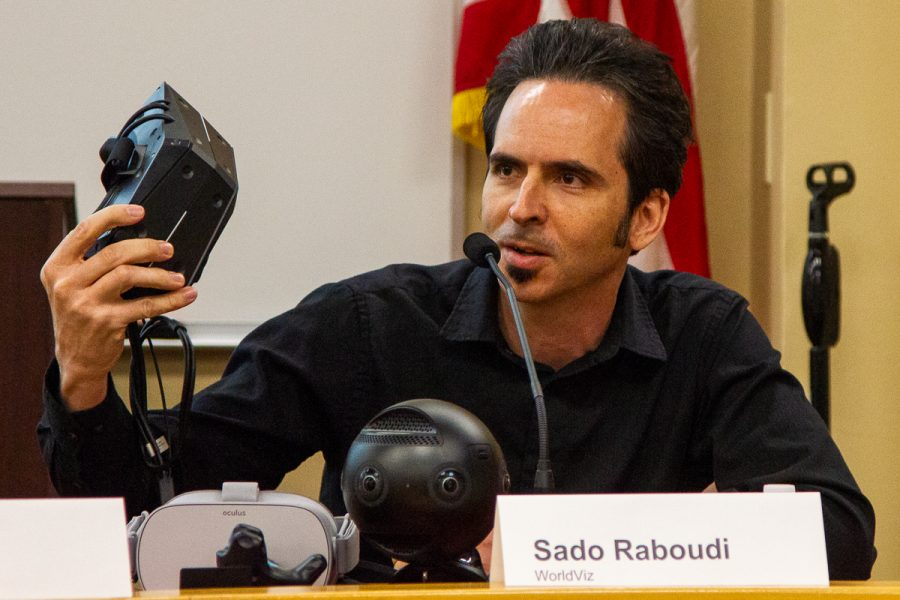 """Sado Raboudi, a business development solutions architect for WorldViz, during the """"How I Made It"""" panel about job opportunities in the gaming world on Wednesday, Nov. 14, in the Administration Building at City College in Santa Barbara, Calif. Raboudi was showing the audience a virtual reality headset and welcomed anyone to use it after the discussion."""